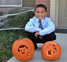 A proud little pumpkin carver :)