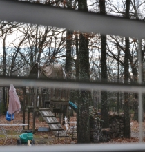 Looking out at an abandoned winter playground.